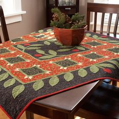 Create a beautiful holiday table topper that echoes the seasonal appliqué on both the quilt center and outer border.