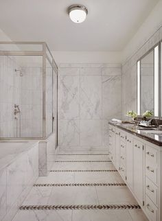Thomas O'Brian's influence on The Greenwich Lane development in the West Village. Note: nickel edged shower which matches the mirror surrounds, the stripped floor and countertop.