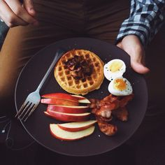 Toasted pumpkin waffle topped with cinnamon-sugar apple compote and Canadian maple syrup  Side of: Fresh Washington apple slices, soft-boiled egg, and bacon strips