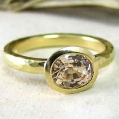 This gold engagement ring by Alexis Dove is inspired by one of her greatest passions: the vintage style.