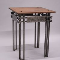 We created this end table from hand-forged reclaimed steel and reclaimed walnut. © Phoenix Handcraft