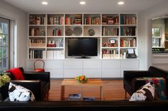 """make the upper shelves 13 to 14 inches deep (instead of the more common 12). """"That will accommodate most books really well,"""" he says. To prevent sagging, use plywood shelving and keep spans under 48 inches (36 inches is ideal)."""
