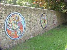 Mosaic outdoor wall art - circles within circles. Good idea for collaborative work