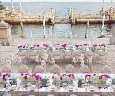Wedding guests dine at stunning banquet tables overlooking Biscayne Bay.