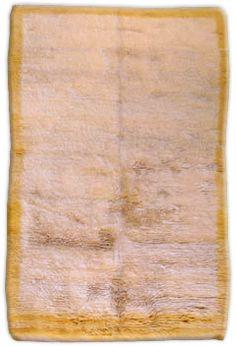A second quarter 20th century Turkish Tulu rug having an open oatmeal field…