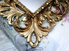 Foglia oro su cornice in legno