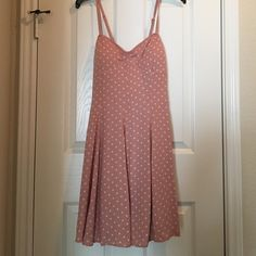 American Eagle polka dot dress Only worn for pictures. New. Rose colored with white polka dots. Tie back with a little back exposure. Adjustable straps. Fun & flirty! American Eagle Outfitters Dresses