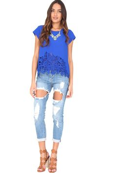 Light wash fitted boyfriend jeans featuring heavy distressing on front panels and 5-pocket style. Get the celebrity look for half the price! Stay on trend with these awesome jeans!