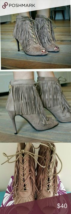 Fringe lace up bootie Super cute Fringe lace up bootie, 4 in heel super comfortable. Reposting got as a gift for friend and didn't  fit her. Color of the shoe looksmore like the last 3rd picture . Color goes with everything!! Never worn she just tried it on in the house Shoes Ankle Boots & Booties