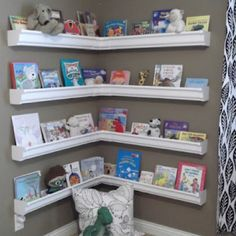 Book shelves from vinyl rain gutters - for the reading nook!