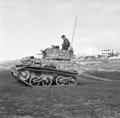 A British Light Tank Mk VI, wearing distinctive camouflage, on a firing range on Malta, 24 March 1942.