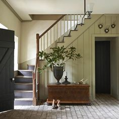 A #rustictrunk is the focal point of this delightful #entryway and also features on the cover of #thegreatamericanhouse by @gpschafer  Explore our exquisite range of #French  furniture, home wares and bespoke artisan creations via link in profile.  #inspo #rusticfarmhouse #modernfarmhouse #modernrustic #farmhousestyle #rustichome #rusticstyle #bespoke #weathered #americanfarmhouse #vintageinterior #swoon #statement #mismatched