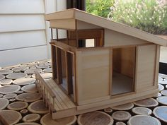 the gears are already turning to figure out how to make a doghouse like this dollhouse
