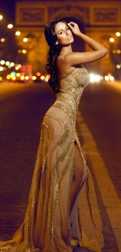 this is a really georgous dress, this is also a really cool pic but what would a model in a really exspensive dress b doing out in the middle of the road? just wondering...