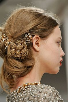 At Oscar de la Renta, this messy, jewel-encrusted look is romantic, wispy, woven texture, accented with clusters of huge jewels.