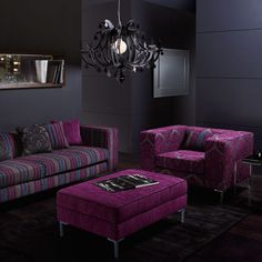 Beautiful broody Warwick fabrics ROYALSTON in this loungeroom, I particularly like the purple fabric on the ottoman.