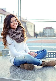 White sweater, ripped jeans, boots, chunky-knit taupe infinity scarf