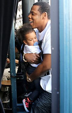 Blue Ivy with her dad in Paris