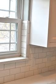 Kitchen Backsplash By Window subway tile at window with wooden sill and skirt via http