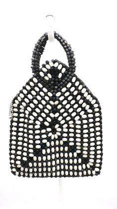 """Vintage wooden bead purse made in Czechoslovakia, also know as """" Czech Bead Purse"""" in stunning black and white pattern. This one is a larger, more rare, one with unique cut out beaded handles. Zipper"""