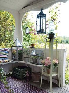 Lanterns, benches & flowers - plus cute cut-out columns from gardenrooms.typepad.com #porch