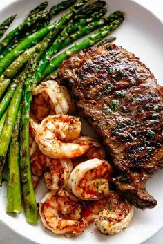 Grilled Steak & Shrimp (SURF AND TURF) slathered in garlic butter makes for the BEST steak recipe! A gourmet steak dinner that tastes like something out of a restaurant, ready and on the table in less than 15 minutes. Good Steak Recipes, Grilled Steak Recipes, Healthy Diet Recipes, Meat Recipes, Seafood Recipes, Healthy Eating, Cooking Recipes, Grilled Steaks, Best Grilled Steak
