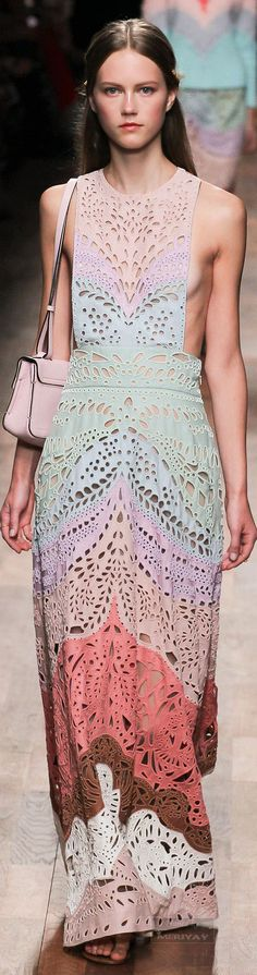 Valentino.Spring 2015. An interesting pattern is created in the negative space of the cut outs on this long and flowing dress.