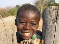 Boy from Borehole 36 school in Zimbabwe.  Happy that his village finally had a working water pump.