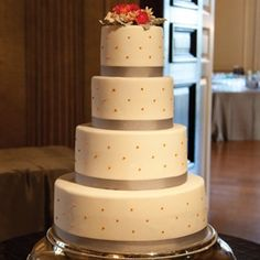 Simple Orange and Gray Wedding Cake  colored ribbon colored dots and gerber daisies on top
