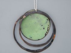 Handmade jewelry. Sterling silver and green enamel necklace with blackened copper rings