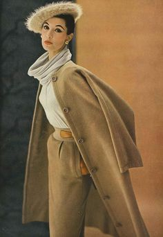 September Vogue 1952    Model is wearing an outfit by Claire McCardell. 50s fashion style tan beige brown suit long jacket pencil skirt color photo print ad