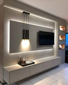 5 Amazing Ways to Upgrade Your Living Room TV Wall - Are you bored with the same old flat screen arrangement? Then why not try one of these five amazing ideas for your living room TV wall. Tv Unit Decor, Tv Wall Decor, Wall Tv, Bedroom Tv Wall, Tv Area Decor, Tv Wall Panel, Bedroom Wall Designs, Wall Decor Lights, Wall Shelving