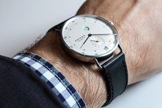 "Nomos Glashütte Metro Watch Hands-On - by James Stacey - See more Metro, read about Nomos' daring new in-house assortiment, the ""Swing System"" - ""Nomos is a small German brand that is hell-bent on doing things their own way. They have a unique style derived from the Deutscher Werkbund movement and Bauhaus aesthetic and, since their birth shortly after the fall of the Berlin wall, they have stuck to their principles and developed an identify..."" #ABTWBaselworld2014"