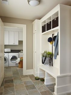 Slate tile flooring in laundry room with cute pet station and mudroom    Express Flooring   Phoenix, Arizona