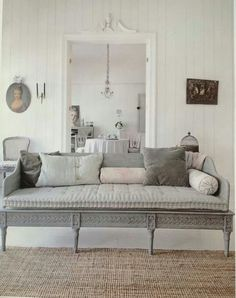 Gustavian style. Sofa at end of bed with built in storage