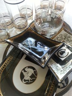 We are crazy for black and gold vintage barware for the Holidays.