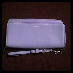 Stunning blue NWOT Coach leather wallet/wristlet Stunning and brand new Coach baby blue wallet and wristlet. Space for cards, cash, checkbook. In perfect condition. Has been stored, but never actively used. Coach Bags Wallets