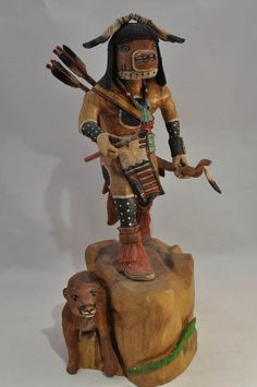 Kachina Doll by Milton Howard, Mountain Lion Katsina  Hand Carved and Painted Cottonwood Root 8 1/4 x 5 3/4 x 3 1/4 inches  $980.00. AAIA, Inc. deals in antique & contemporary Native American Indian art and artifacts. We Buy, Sell, Consign, Appraise, Restore & Research. #Antique #American #Indian #Art (949) 813-7202 mwindianart@gmail.com