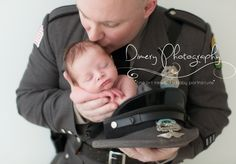 newborn baby sleeping in police officer hat, dimery ...