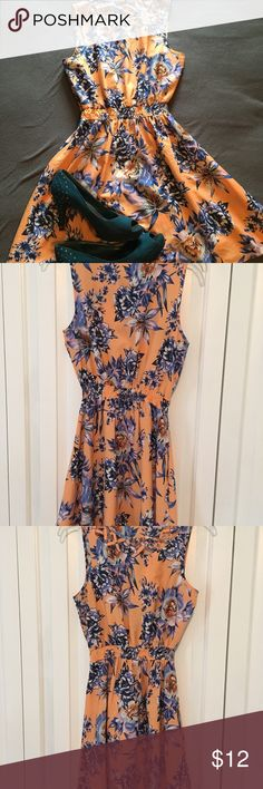 Floral/ tropical print dress.  Summer/party dress Peach and blue floral/ tropical print dress.  Perfect as a sun dress or for special occasions including Bridal showers or a wedding.  Only worn a few times.  Very light weight with some slight stretch in the waist.  100% polyester.  U.K. Size 8 equivalent to size M Dresses Midi