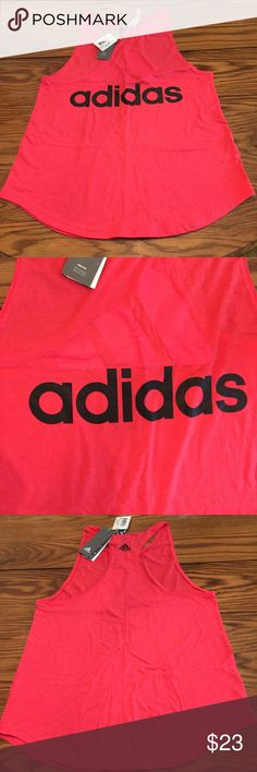 NWT Adidas Essentials Linear Loose Tank •sporty Tank enlivened with contrast graphic •roundneck •Pullover style  •curved hem •recycled Polyester/ cotton/ viscose •color: coral pink   🌻NO TRADES 🌻OFFERS WELCOMED! 🌻BUNDLE TO SAVE  🌻FEEL FREE TO ASK ANY QUESTIONS adidas Tops Tank Tops