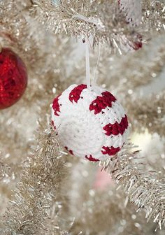 Crochet a peppermint ornament to hang on your tree. Christmas Crochet Patterns, Crochet Christmas Ornaments, Noel Christmas, Christmas Knitting, Christmas Decorations, Crochet Snowflakes, Angel Ornaments, Christmas Pillow, Christmas Candy