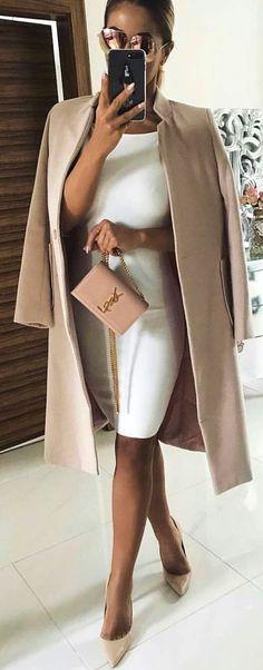 white bodycon dress and beige coat