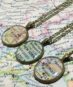 A Romantic travel gift idea for the travel lover in your life... vintage map necklaces of a special place for you both. They also make cufflinks and more.