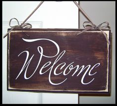 I'm going to be painting a Welcome sign for my daughter's new apartment.  She want's a rustic almost chalkboard effect and I think this is similar to what she's wanting;   I like the idea of the frame around the edge.  That should work.