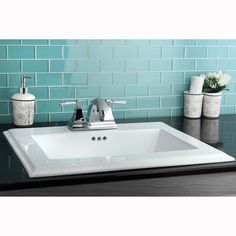 Its easy to update your bathroom with this white bath sink. This surface mount sink is made from vitreous china to give it a long-lasting shine that is stain resistant and easy to clean. Give your bathroom an easy makeover with this contemporary sink.