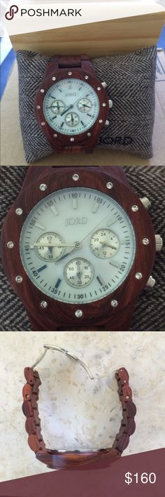 JORD wooden watch with Crystal and mother of pearl This is something else. Jord watch made with red sandalwood, mother of pearl and Swarovski crystal inlay.  Brand new and comes with original wooden box and extra wooden links to increase the size.  Not subject to my bundle discount. JORD Accessories Watches