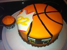 Basketball Birthday Cake - A basketball themed birthday cake for my nephew's 12th birthday that included 12 cupcakes - one for each boy on the team.