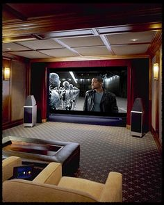 The loudspeakers for the theater system are concealed behind the perforated Stewart Filmscreen (a hallmark of ALL my theater designs). The Wilson Audio loudspeakers visible in the photo are for a dedicated 2-channel music system. Another hallmark design of mine, particularly appealing to audiophiles: a 'music room' within a private cinema.