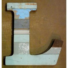 These Paul Michael Company Exclusive pieces are designed and made by hand in our Dermott, AR woodshop. Each letter is made from recycled wood and hand finished. Each letter is unique and varies.